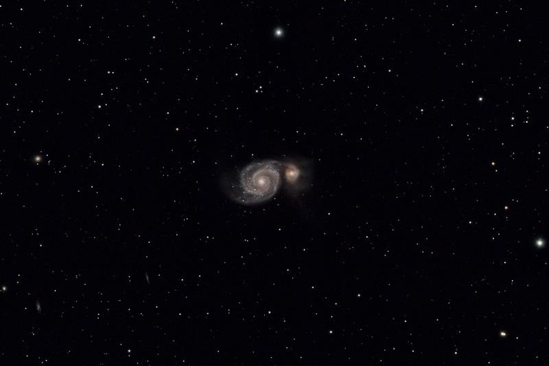 Target: M51 (NGC 5194, Whirlpool Galaxy, spiral galaxy in Canis Venatici, apparent dimension 11 x 7 arcmin, magnitude 8.4 on left) and NGC 5195, irregular galaxy, apparent dimension 6.4 x 4.6 arcmin, magnitude 9.6 on right)<br /> <br /> Distance from Earth:  37 million light-years<br /> <br /> Image FOV:  77 x 51 arcmin<br /> <br /> Date/Time: 06/01/08 2215 EDT to 06/02/08 0420 EDT<br /> <br /> Mount: Takahashi NJP Temma II<br /> <br /> Telescope: Takahashi TOA-130 refractor with Tak 0.98x flattener (f/7.5) and Hutech LPS filter<br /> <br /> Camera: Starlight Xpress SXVF-M25C ccd guided by SX Autoguider with Takahashi FS-60C refractor (f/5.9)<br /> <br /> Focus: Finger Lakes Instrumentation DF-2 focuser with FocusMax/MaxIm DL software<br /> <br /> Sky conditions:  transparency 3/5, seeing 3/5<br /> <br /> Moonrise:  06/02/08 0420 EDT<br /> <br /> Images: Captured with MaxIm DL 4.60 at an image scale of 1.64 arcsec/pixel; 20 light exposures, 900 sec duration; 1, 900 sec dark frame; 27, 8 sec flat_light frames; 1, 8 second flat_dark frame and 27, 0.1 sec bias frames.  17 frames were used for alignment and stacking.<br /> <br /> Processing: ImagesPlus 3.5 and Photoshop CS3 with GradientXTerminator and Noise Ninja; luminance data split from RGB data, processed and recombined with RGB data to create a luminance corrected LRGB image; image cropped and downsampled (revised 07/27/08)