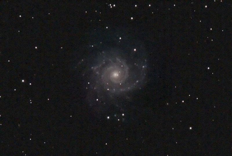 Target:  M74 (NGC 628, spiral galaxy in Pisces, apparent dimension 10.2x9.5 arcmin, magnitude 9.4)<br /> <br /> Distance from Earth:  35 million light-years<br /> <br /> Date/Time:  11/24/06, 1910 EST to 11/25/06, 0600 EST<br /> <br /> Mount:  Takahashi NJP Temma II<br /> <br /> Telescope:  Tak TOA-130 with 1.6x extender (f/12.3) and Hutech LPS filter<br /> <br /> Camera:  Modified Canon EOS 350D guided by Takahashi FS-60C with SBIG STV (f/5.9)<br /> <br /> Focus:  VSE MicroGlide with RoboFocus and ImagesPlus 2.80<br /> <br /> Sky conditions:  transparency 4/5, seeing 4/5, wind calm, humidity 80 to 85%, temp 44.8F at beginning and 32F at conclusion<br /> <br /> Moon:  4.1 day old, 0.172 illuminated, mag -8.4<br /> <br /> Images:  Captured with ImagesPlus 2.80 at an image scale of 0.82 arcsec/pixel; 18 light exposures (13 aligned and combined), 600 sec duration, 0 sec delay, 10 sec interval, ISO 400; dark, flat and bias frames captured<br /> <br /> Processing:  ImagesPlus 2.80, Picture Window Pro 4.0 and Photoshop CS 8.0 with GradientXTerminator and Noise Ninja, image cropped