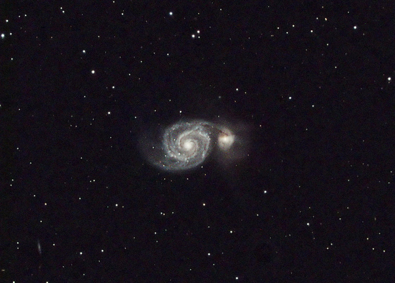 Target: M51 (NGC 5194, Whirlpool Galaxy, spiral galaxy in Canis Venatici, apparent dimension 11 x 7 arcmin, magnitude 8.4 on left) and NGC 5195, irregular galaxy, apparent dimension 6.4 x 4.6 arcmin, magnitude 9.6 on right)<br /> <br /> Distance from Earth:  37 million light-years<br /> <br /> Date/Time: 04/22/07, 0030 EDT to 0135 EDT and 04/23/07, 0250 EDT to 0450 EDT<br /> <br /> Mount: Takahashi NJP Temma II<br /> <br /> Telescope: Takahashi FS-78 with Optec 0.62x reducer (f/5.0) and Hutech LPS filter<br /> <br /> Camera: Starlight Xpress SXVF-M8C ccd guided by SBIG STV with Takahashi FS-60C refractor (f/5.9)<br /> <br /> Focus: VSE Epsilon, RoboFocus and AstroArt 4.0<br /> <br /> Sky conditions: transparency 4/5, seeing 4/5, wind 0-5 mph, humidity 55.60%, temp O/I 54.0/54.1F at beginning and 48.0/50.2F at conclusion (first night) and 57.9/60.3F & 54.1/57.4F (second night)<br /> <br /> Moon:  4.7 day old, 0.286 illuminated, mag -9.1 (first night); 5.8 day old, 0.399 illuminated, mag -9.8 (second night)<br /> <br /> Images: Captured with AstroArt 4.0 at an image scale of 1.63 arcsec/pixel; first night 15 light exposures, 240 sec duration; dark & flat frames captured; second night 30 light exposures, 240 sec.  44 images used for processing<br /> <br /> Processing: AstroArt 4.0, ImagesPlus 3 beta 1D, Picture Window Pro 4.0 and Photoshop CS 8.0 with GradientXTerminator and Noise Ninja, image cropped