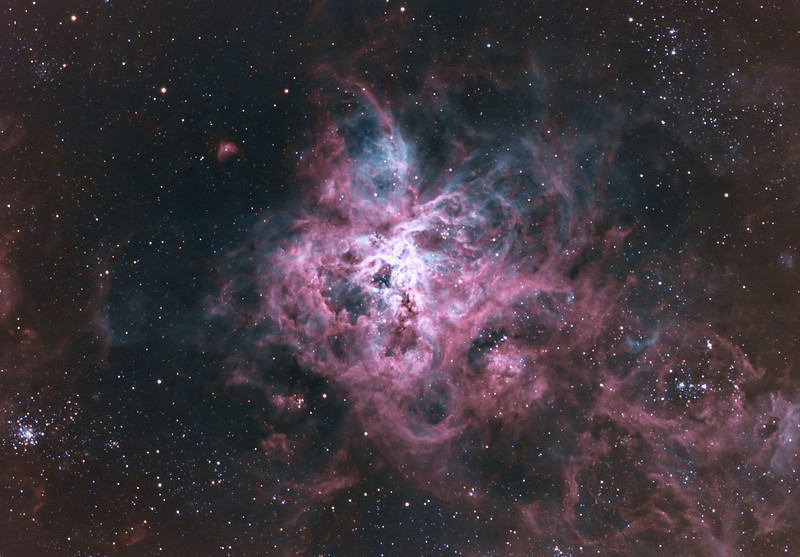 Target:  NGC 2070 (Tarantula Nebula, emission  nebula in Dorado) in tri-color narrowband ([Ha+SII] + OIII + [OIII+Ha]) for synthetic RGB and RGB wideband (for star color)<br /> <br /> Distance from Earth:  179,000 light-years<br /> <br /> Image FOV:  38 x 26 arcmins<br /> <br /> Telescope: PlaneWave CDK 20 (f/4.5)<br /> <br /> Camera: FLI ProLine PL6303E<br /> <br /> Images: Data captured at an image scale of 0.81 arcsec/pixel (binned 1x1); 32, 600 sec narrowband subexposures and 5, 60 sec each RGB subexposures; 180 minutes (S2), 60 minutes (Ha), 80 minutes (OIII) and 45 min (RGB) on Jan 26, 29, 30, 31 and Feb 6, 2013; total exposure time of 365 minutes<br /> <br /> Processing: MaxIm DL 5.18, CCDStack 1.0.7, Registar 1.0 and Photoshop CS3, image cropped