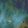 Target:  IC 2944  (Running Chicken Nebula, star cluster associated with emission  nebula in Centaurus with Bok Globules) in tri-color narrowband (SII + Ha + OIII), SHO mapped to RGB (Hubble palette)<br /> <br /> Distance from Earth:  6000 light-years<br /> <br /> Image FOV:  33 x 27 arcmins<br /> <br /> Telescope: PlaneWave CDK 20 (f/4.5)<br /> <br /> Camera: FLI ProLine PL6303E<br /> <br /> Images: Data captured at an image scale of 0.81 arcsec/pixel (binned 1x1); 37, 600 sec subexposures; 200 minutes (S2), 30 minutes (Ha) and  140 minutes (OIII) in Mar & Apr 2013; total exposure time of 370 minutes<br /> <br /> Processing: MaxIm DL 5.18, CCDStack 1.0.7, Registar 1.0 and Photoshop CS3 with GradientXTerminator and StarSpikes Pro, image cropped
