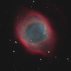 Target:  NGC 7293 (Helix Nebula, planetary nebula in Aquarius) in bi-color narrowband (Ha + OIII + [OIII+Ha]) for synthetic RGB and RGB wideband (for star color)<br />  <br /> Distance from Earth:  450 light-years<br /> <br /> Image FOV:  35 x 24 arcmins<br /> <br /> Telescope: PlaneWave CDK 20 (f/4.5)<br /> <br /> Camera: FLI ProLine PL6303E<br /> <br /> Images: Data captured at an image scale of 0.81 arcsec/pixel (NB data binned 1x1; RGB data binned 2x2); 65, 600 sec narrowband subexposures and 27, 60 sec RGB subexposures;  230 minutes Ha, 420 minutes OIII and 27 min (RGB) on June 24, 2013 through Sept 1, 2013; total exposure time of 677 minutes<br /> <br /> Processing: MaxIm DL 5.18, CCDStack 1.0.7, Registar 1.0 and Photoshop CS3 with Noise Ninja and StarSpikes Pro, image cropped