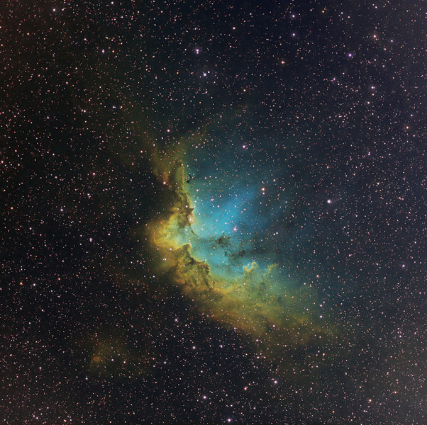 Target:  NGC 7380 (open cluster in Cepheus) and Sharpless 142 (The Wizard, emission nebula associated with open cluster) in tri-color narrowband (SII + Ha + OIII)<br /> <br /> Distance from Earth:  10,000 light-years<br /> <br /> Image FOV: 66 x 65 arcmin<br /> <br /> Telescope: Takahashi TOA-130 (f/6.0) <br /> <br /> Camera: Starlight Xpress SXVR-H16<br /> <br /> Images: Captured at an image scale of 1.96 arcsec/pixel (binned 1x1); 59, 900 sec subexposures; 480 minutes (S2), 120 minutes (Ha) and 285 minutes (O3); total exposure time of 885 minutes on Jun 15, 27, 29, 30 and Jul 1, 2011<br /> <br /> Processing: MaxIm DL 5.12 and Photoshop CS3 with Noise Ninja; image cropped