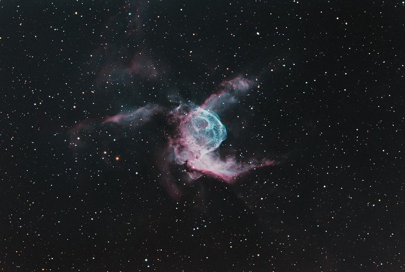 Target:  NGC 2359 (Thor's Helmet, emission and reflection nebula in Canis Major) in bi-color narrowband (Ha + OIII + [OIII + 20% Ha]) and RGB wideband (for star color)<br /> <br /> Distance from Earth:  15,000 light-years<br /> <br /> Image FOV:  39 x 26 arcmins<br /> <br /> Telescope: PlaneWave CDK 20 (f/4.5)<br /> <br /> Camera: FLI ProLine PL6303E<br /> <br /> Images: Data captured at an image scale of 0.81 arcsec/pixel (binned 1x1); 41, 120 sec wideband subexposures and 33, 600 sec narrowband subexposures; 190 minutes (OIII), 140 minutes (Ha), 28 minutes (R), 24 minutes (G) and 30 minutes (B) on Dec 30, 2012 and Jan 8, 10, 11, 2013; total exposure time of 412 minutes<br /> <br /> Processing: MaxIm DL 5.18, CCDStack 1.0.7, Registar 1.0 and Photoshop CS3 with Noise Ninja and StarSpikes Pro, image cropped