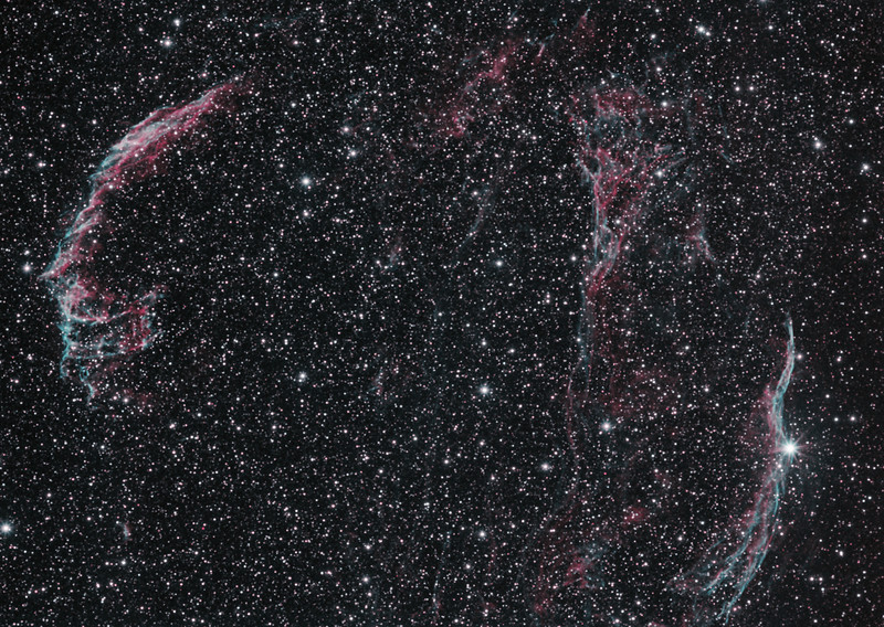 Target:  Veil Nebula (supernova remnent in Cygnus)  in bi-color narrowband (Ha + O3) to produce a synthetic RGB image<br /> <br /> Distance from Earth:  1500 light-years<br /> <br /> Image FOV: 183 x 130 arcmin<br /> <br /> Mount: Takahashi NJP Temma II<br /> <br /> Telescope: Pentax 6x7 165mm lens (f/5.6) and Astronomik 14nm Ha and 15nm O3 filters <br /> <br /> Camera: Starlight Xpress SXVF-H9 ccd guided by SX Exview Autoguider with Takahashi FS-60C refractor (f/5.9)<br /> <br /> Focus: Finger Lakes Instrumentation PDF focuser with FocusMax/MaxIm DL software<br /> <br /> Images: Captured with MaxIm DL 5.10 at an image scale of 8.00 arcsec/pixel; 240 minutes (Ha) and 220 minutes (O3); total exposure time of 460 minutes (23, 1200 sec subexposures) on Aug 15, 16, 2010<br /> <br /> Processing: MaxIm DL 5.10 and Photoshop CS3; Ha and O3 images processed individually in MaxIm DL.  Ha, O3 and (O3 +20% Ha) data mapped to R, G and B channels and combined in PS to produce an RGB image; image cropped