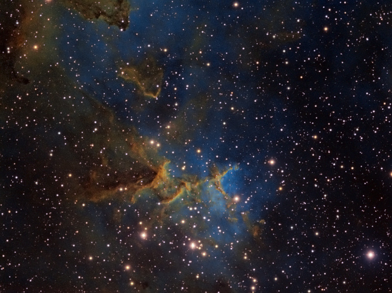 Target: Region of IC1805 (Heart Nebula, emission nebula in Cassiopeia)  in tri-color narrowband (SII + Ha + OIII)<br /> <br /> Distance from Earth:  7500 light-years<br /> <br /> Image FOV:  36 x 27 arcmins<br /> <br /> Mount: Takahashi NJP Temma II<br /> <br /> Telescope: Takahashi TOA-130 refractor with TOA-130 0.78x reducer (f/6.0) and Astronomik 12nm SII filter, Astronomik 12nm Ha filter and Astronomik 12nm OIII filter. <br /> <br /> Camera: Starlight Xpress SXVF-H9 ccd guided by SX Autoguider with Takahashi FS-60C refractor (f/5.9)<br /> <br /> Focus: Finger Lakes Instrumentation DF-2 focuser with FocusMax/MaxIm DL software<br /> <br /> Images: Captured with MaxIm DL 4.60 at an image scale of 1.69 arcsec/pixel; 410 minutes (SII data), 250 minutes (Ha) and 270 minutes (OIII); total exposure time of 930 minutes on Sept 18, 19, 30, 2009 and Oct 2, 2009<br /> <br /> Processing: MaxIm DL 5.05 and Photoshop CS3 with Noise Ninja and Astronomy Tools; SII, Ha and OIII images processed individually in MaxIm DL and copied into PS.  SII, Ha and OIII data mapped to R, G and B channels and combined in PS to produce an RGB image; image cropped (revised 10/04/09)