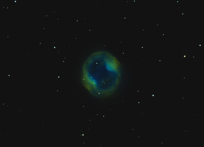 Target:  PK164+31.1 (planetary nebula in Lynx) in tri-color narrowband (SII + Ha + OIII) using the Hubble palette<br /> <br /> Distance from Earth:  1600 light-years<br /> <br /> Image FOV:  28 x 20 arcmins<br /> <br /> Mount: Takahashi NJP Temma II<br /> <br /> Telescope: Takahashi TOA-130 refractor with TOA-130 0.98x flattener (f/7.5) and Astrodon 5nm SII, 5nm Ha and 3nm OIII filters<br /> <br /> Camera: Starlight Xpress SXVF-H9 ccd guided by SX Autoguider with Takahashi FS-60C refractor (f/5.9)<br /> <br /> Focus: Finger Lakes Instrumentation DF-2 focuser with FocusMax/MaxIm DL software<br /> <br /> Images: Captured with MaxIm DL 4.60 at an image scale of 1.34 arcsec/pixel; 135 minutes (SII data), 90 minutes (Ha) and 120 minutes (OIII); total exposure time of 345 minutes on March 30, 31; Apr 1, 2010<br /> <br /> Processing: MaxIm DL 5.05 and Photoshop CS3 with Noise Ninja and Astronomy Tools; SII, Ha and OIII images processed individually in MaxIm DL.  SII, Ha and OIII data mapped to R, G and B channels and combined in PS to produce an RGB image; image cropped
