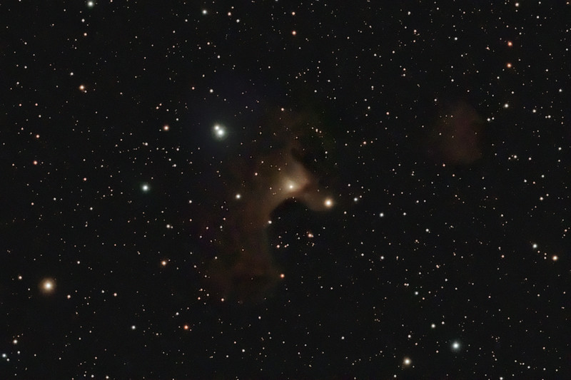 Target:  Sharpless 136 (Ghost Nebula, reflection nebula in Cepheus) <br /> <br /> Distance from Earth:  1500 light-years<br /> <br /> Image FOV:  44 x 29 arcmins<br /> <br /> Telescope: Takahashi TOA-130 refractor with Tak 0.98x flattener (f/7.5) and Hutech LPS filter<br /> <br /> Camera: Starlight Xpress SXVF-M25C ccd guided by SX Autoguider with Takahashi FS-60C refractor (f/5.9)<br /> <br /> Focus: Finger Lakes Instrumentation DF-2 focuser with FocusMax/MaxIm DL software<br /> <br /> Images: Captured with MaxIm DL 4.60 at an image scale of 1.64 arcsec/pixel; total exposure time of 205 minutes on Jul 24, 20, 2009<br /> <br /> Processing: MaxIm DL 5.05 and Photoshop CS3 with Noise Ninja and GradientXTerminator; image cropped