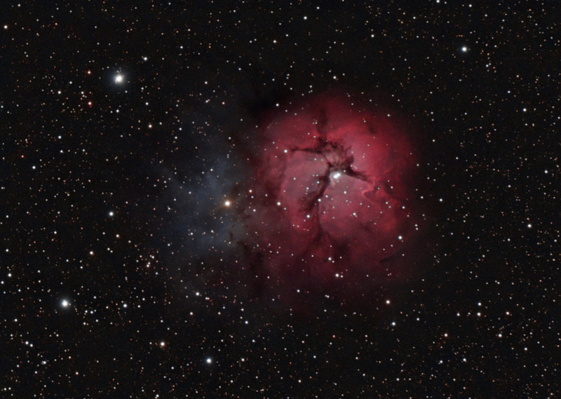 Target: M20 (NGC 6514, Trifid Nebula, emission and reflection nebula in Sagittarius)<br /> <br /> Distance from Earth:  5200 light-years<br /> <br /> Image FOV:  38 x 27 arcmins<br /> <br /> Telescope: Takahashi TOA-130 refractor with TOA-130 0.78x reducer (f/6.0) and Hutech LPS filter<br /> <br /> Camera: Starlight Xpress SXVF-H9C ccd guided by SX Autoguider with Takahashi FS-60C refractor (f/5.9)<br /> <br /> Focus: Finger Lakes Instrumentation PDF focuser with FocusMax/MaxIm DL software<br /> <br /> Images: Captured with MaxIm DL 5.08 at an image scale of 1.69 arcsec/pixel; total exposure time of 130 minutes on Jun 11, 12, 2010<br /> <br /> Processing: MaxIm DL 5.08 and Photoshop CS3 with Noise Ninja & GradientXTerminator; image cropped