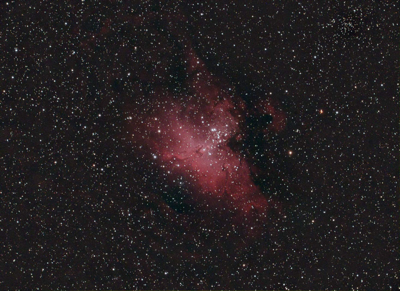 Target: M16 (NGC 6611, Eagle Nebula, emission nebula in Serpens Cauda, apparent dimension 7.0 arcmin, magnitude 6.4)<br /> <br /> Distance from Earth:  7000 light-years<br /> <br /> Date/Time: 09/02/07 2145 EDT to 2347 EDT<br /> <br /> Mount: Takahashi NJP Temma II<br /> <br /> Telescope: Takahashi TOA-130 refractor with Tak 0.75x reducer (f/5.8) and Hutech LPS filter<br /> <br /> Camera: Starlight Xpress SXVF-M25C ccd guided by SBIG STV with Takahashi FS-60C refractor with Optec 0.62x reducer (f/3.7)<br /> <br /> Focus: Finger Lakes Instrumentation DF-2 focuser with FocusMax/MaxIm DL software<br /> <br /> Sky conditions: transparency 4/5, seeing 3/5<br /> <br /> Moon:  Moonrise 2235 EDT, 0.615 illuminated, mag -10.7, 21.1 days old, 1.0 days before third quarter<br /> <br /> Images: Captured with MaxIm DL 4.60 at an image scale of 2.12 arcsec/pixel; 60 light frames, 120 sec duration and 3 dark frames, 120 sec duration; 60 light frames used for processing.<br /> <br /> Processing:  ImagesPlus 3 beta 9 and Photoshop CS3 with GradientXTerminator and Noise Ninja, image cropped