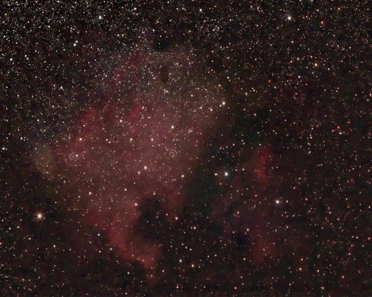 Target: NGC 7000 on left (North America Nebula, emission nebula in Cygnus, apparent dimension 120x100 arcmin) and IC 5067 on right (Pelican nebula, emission nebula in Cygnus, apparent dimension 25x10 arcmin)<br /> <br /> Distance from Earth:  1600 light-years<br /> <br /> Date/Time:  07/01/07, 0205 to 0345 EDT<br /> <br /> Mount:  Takahashi NJP Temma II<br /> <br /> Telescope:  Canon 85mm (f/1.8) FD lens stopped down to f/4.0 and Hutech LPS filter<br /> <br /> Camera: Starlight Xpress SXVF-M8C ccd guided by SBIG STV with Takahashi FS-60C w/ Optec 0.62x reducer (f/3.7)<br /> <br /> Focus: RoboFocus motor with Mandel setup and AstroArt 4.0 autofocus plug-in<br /> <br /> Sky conditions:  transparency 3/5, seeing 2/5, wind 12-16mph, humidity 50-55%, temp (O/I) 56.3/57.4F at beginning and 52.2/55.0F at conclusion<br /> <br /> Moon:  0.993 illuminated, mag -12.5, 16.2 days old, 0.73 days past full<br /> <br /> Images:  Captured with AstroArt 4.0 at an image scale of 7.82 arcsec/pixel; 60 light exposures, 90 sec duration; no dark or flat frames; 29 images used for processing<br /> <br /> Processing:  ImagesPlus 3 beta 5, Picture Window Pro 4.0 and Photoshop CS 8.0 with GradientXTerminator and Noise Ninja; image cropped (revised 08/07/07)