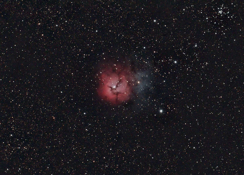 Target: M20 (NGC 6514, Trifid Nebula, emission and reflection nebula in Sagittarius, apparent dimension 28.0 arcmin, magnitude 9.0)<br /> <br /> Distance from Earth:  5200 light-years<br /> <br /> Date/Time: 09/06/07 2122 EDT to 2154 EDT and 09/15/07 2154 EDT to 2302 EDT<br /> <br /> Mount: Takahashi NJP Temma II<br /> <br /> Telescope: Takahashi TOA-130 refractor with Tak 0.75x reducer (f/5.8) and Hutech LPS filter<br /> <br /> Camera: Starlight Xpress SXVF-M25C ccd guided by SBIG STV with Takahashi FS-60C refractor with Optec 0.62x reducer (f/3.7)<br /> <br /> Focus: Finger Lakes Instrumentation DF-2 focuser with FocusMax/MaxIm DL software<br /> <br /> Sky conditions 09/06/07: transparency 4/5, seeing 4/5<br /> <br /> Sky conditions 09/15/07: transparency 4/5, seeing 3/5<br /> <br /> Moon:  Moonset 09/06/07 2235 EDT, Moonset 09/15/07 2102 EDT<br /> <br /> Images: Captured with MaxIm DL 4.60 at an image scale of 2.12 arcsec/pixel; 15 light frames, 120 sec duration and 3 dark frames, 120 sec duration on 09/06/07 and 30 light frames, 120 sec duration and 3 dark frames, 120 sec duration on 09/15/07; 4 and 21 light frames from the 2 nights used for processing.<br /> <br /> Processing:  ImagesPlus 3 beta 6 & 7, RegiStar 1.0  and Photoshop CS3 with GradientXTerminator and Noise Ninja, image cropped