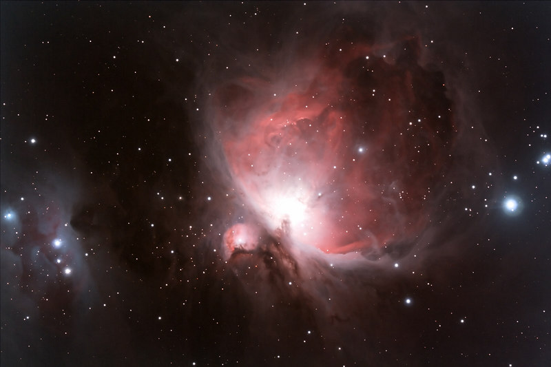 Target:  Orion Nebula; M42 (NGC 1976, emission nebula in Orion, apparent dimension 85x60 arcmin, magnitude 4.0 on right), M43 (NGC 1982, emission nebula in Orion, part of Orion Nebula, apparent dimension 20x15 arcmin, magnitude 9.0 in middle) and Running Man Nebula (NGC 1977, reflection nebula in Orion, apparent diameter 20 arcmin on left)<br /> <br /> Distance from Earth:  1600 light-years<br /> <br /> Date/Time:  10/15/06, 0420 EDT to 0640 EDT<br /> <br /> Mount:  Takahashi NJP Temma II<br /> <br /> Telescope:  Takahashi TOA-130 refractor with Takahashi flattener (f/7.7) and Hutech LPS filter<br /> <br /> Camera:  Modified Canon EOS 350D guided by Takahashi FS-60C with Optec 0.62x telecompressor with SBIG STV (f/3.7)<br /> <br /> Focus:  VSE MicroGlide with RoboFocus and ImagesPlus 2.80<br /> <br /> Sky conditions:  transparency 3/5, seeing 3/5, wind light to moderate, humidity 75 to 80%, temp O/I 33.4/36.1F at beginning and 31.1/34.2F at conclusion<br /> <br /> Moon:  22.9 day old, 0.371 illuminated, mag -9.2<br /> <br /> Images:  Captured with ImagesPlus 2.80 at an image scale of 1.52 arcsec/pixel; 5 light exposures, 480 sec duration, 0 sec delay, 10 sec interval, ISO 400; dark, flat and bias frames captured<br /> <br /> Processing:  ImagesPlus 2.80, Picture Window Pro 4.0 and Photoshop CS 8.0 with Noise Ninja