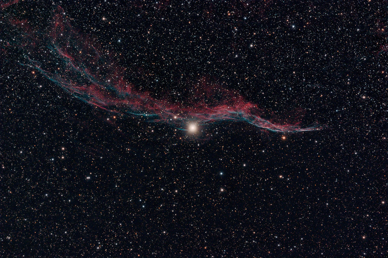 Target:  NGC 6960 (Western Veil Nebula, supernova remnent in Cygnus)<br /> <br /> Distance from Earth:  1500 light-years<br /> <br /> Image FOV:  82 x 55 arcmin<br /> <br /> Date/Time: 09/02/08 2115 EDT to 09/03/08 0441 EDT<br /> <br /> Mount: Takahashi NJP Temma II<br /> <br /> Telescope: Takahashi TOA-130 refractor with Tak 0.98x flattener (f/7.5) and Hutech LPS filter <br /> <br /> Camera: Starlight Xpress SXVF-M25C ccd guided by SX Autoguider with Takahashi FS-60C refractor (f/5.9)<br /> <br /> Focus: Finger Lakes Instrumentation DF-2 focuser with FocusMax/MaxIm DL software<br /> <br /> Sky conditions:  transparency 4/5, seeing 3/5<br /> <br /> Moonset:  09/02/08 2053 EDT<br /> <br /> Images: Captured with MaxIm DL 4.60 at an image scale of 1.64 arcsec/pixel; 32 light exposures, 600 sec duration; 1, 600 sec dark frame; 27, 1.0 sec flat_light frames using a lightbox; 1, 1.0 second flat_dark frame and 27, 0.1 sec bias frames.  29 frames were used for alignment and stacking.<br /> <br /> Processing: MaxIm DL 5.00, DeepSkyStacker 3.2.2 and Photoshop CS3 with GradientXTerminator and Astronomy Tools, image cropped and downsampled (revised 03/16/09))
