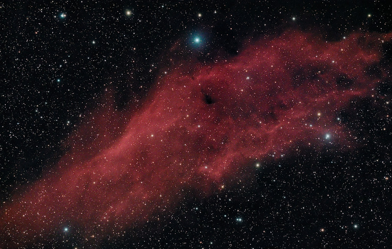 Target:  NGC 1499 (California Nebula, emission nebula in Perseus)<br /> <br /> Distance from Earth:  1500 light-years<br /> <br /> Image FOV: 135 x 86 arcmins (maximum FOV:  151 x 100 arcmins)<br /> <br /> Date/Time: 12/28/08 1951 EST to 12/29/08 0308 EST<br /> <br /> Mount: Takahashi NJP Temma II<br /> <br /> Telescope: Takahashi FS-78 refractor with Hutech 0.85x reducer/flattener (f/6.9) and Hutech LPS filter<br /> <br /> Camera: Starlight Xpress SXVF-M25C ccd guided by SX Autoguider with Takahashi FS-60C refractor (f/5.9)<br /> <br /> Focus: Finger Lakes Instrumentation DF-2 focuser with FocusMax/MaxIm DL software<br /> <br /> Sky conditions:  transparency 3/5, seeing 1/5<br /> <br /> Moonset:  12/28/08 1805 EST<br /> <br /> Images: Captured with MaxIm DL 4.60 at an image scale of 2.99 arcsec/pixel; 25 light exposures, 600 sec duration; 1, 600 sec dark frame; 27, 0.6 sec flat_light frames; 27, 0.6 second flat_dark frame and 27, 0.1 sec bias frames.  24 frames were used for alignment and stacking<br /> <br /> Processing: MaxIm DL 5.0 and Photoshop CS3 with Noise Ninja, GradientXTerminator and Focus Magic; image cropped and downsampled (revised 03/16/09)