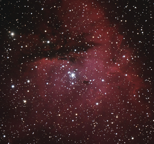 Target:  NGC 281 (Pac-Man Nebula, emission nebula in Cassiopeia) in OSC + Ha data<br /> <br /> Distance from Earth:  10,000 light-years<br /> <br /> Image FOV:  28 x 26 arcmins<br /> <br /> Telescope: Takahashi TOA-150 refractor (f/7.3) (for OSC data) and Takahashi TOA-130 refractor with TOA-130 0.78x reducer (f/6.0) and Astrodon 5nm Ha filter (for Ha data)<br /> <br /> Camera: SBIG ST2000 XMC ccd (for OSC) and Starlight Xpress SXVF-H9 ccd (for Ha)<br /> <br /> Focus: Autofocus<br /> <br /> Images: OSC data captured from GRAS-003 in Mayhill, NM at an image scale of 1.39 arcsec/pixel; total exposure time of 80 minutes on Sep 28, 2010 and Ha data captured in Pittsburgh, PA at an image scale of 1.69 arcsec/pixel; total exposure time of 180 minutes on Nov 3, 4, 6, 2009<br /> <br /> Processing: MaxIm DL 5.05 & 5.12, RegiStar 1.0 and Photoshop CS3 ; final image scale 1.69 arcsec/pixel, image cropped