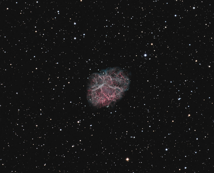 Target: M1 (NGC 1952, Crab Nebula, supernova remnant in Taurus)<br /> <br /> Distance from Earth:  6300 light-years<br /> <br /> Image FOV:  29 x 23 arcmins<br /> <br /> Telescope: PlaneWave CDK 20 (f/6.8) (for LRGB) and Takahashi TOA-130 refractor with TOA-130 0.78x reducer (f/6.0) (for Ha & O3)<br /> <br /> Camera: FLI ProLine PL11002M ccd (for LRGB) and Starlight Xpress SXVF-H9 ccd (for Ha and O3)<br /> <br /> Images: Ha and O3 data captured from my own observatory in Pittsburgh, PA at an image scale of 1.64 arcsec/pixel; 30, 1200 sec subexposures, 360 minutes with the Ha filter on Nov 13, 14, 2009 and 240 minutes with the O3 filter on Nov 18, 2009.  LRGB data captured from GRAS-011 in Mayhill, NM at an image scale of 0.54 arcsec/pixel; 30, 180 sec subexposures; 45 minutes (L), 15 minutes (R), 15 minutes (G) and 15 minutes (B), 90 minutes on Jan 22, 2011; total exposure time of 700 minutes<br /> <br /> Processing: MaxIm DL 5.12, RegiStar 1.0 and Photoshop CS3 with GradientXTerminator and Noise Ninja; final image scale 0.54 arcsec/pixel, image cropped