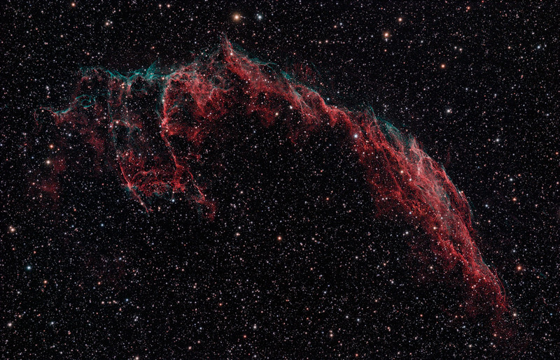 Target:  NGC 6992 (Eastern Veil Nebula, supernova remnent in Cygnus, apparent dimension 8 x 60 arcmin, magnitude 7.0)<br /> <br /> Distance from Earth:  1500 light-years<br /> <br /> Image FOV: 81 x 52 arcmin<br /> <br /> Date/Time:  09/01/08 2134 EDT to 0435 EDT<br /> <br /> Mount:  Takahashi NJP Temma II<br /> <br /> Telescope: Takahashi TOA-130 refractor with Tak 0.98x flattener (f/7.5) and Hutech LPS filter <br /> <br /> Camera: Starlight Xpress SXVF-M25C ccd guided by SX Autoguider with Takahashi FS-60C refractor (f/5.9)<br /> <br /> Focus: Finger Lakes Instrumentation DF-2 focuser with FocusMax/MaxIm DL software<br /> <br /> Sky conditions:  transparency 4/5, seeing 4/5<br /> <br /> Moonset:  09/01/08 2030 EDT<br /> <br /> Images: Captured with MaxIm DL 4.60 at an image scale of 1.64 arcsec/pixel; 30 light exposures, 600 sec duration; 1, 600 sec dark frame; 27, 1.0 sec flat_light frames; 1, 1.0 second flat_dark frame and 27, 0.1 sec bias frames.  25 frames were used for alignment and stacking.<br /> <br /> Processing: MaxIm DL 5.00 and Photoshop CS3 with GradientXTerminator and Astronomy Tools, image cropped and downsampled (revised 03/16/09)