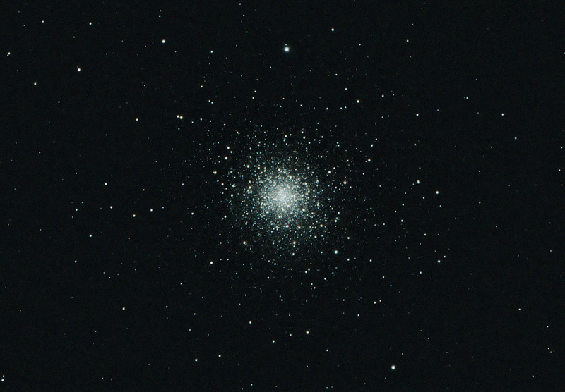 Target: M92 (NGC 6341, globular cluster in Hercules, apparent dimension 14.0 arcmin, magnitude 6.4)<br /> <br /> Distance from Earth:  26,700 light-years<br /> <br /> Date/Time: 06/16/07, 2255 EDT to 06/17/07 0005 EDT<br /> <br /> Mount: Takahashi NJP Temma II<br /> <br /> Telescope:  Takahashi TOA-130 with 0.98x reducer  (f/7.5) and Hutech LPS filter<br /> <br /> Camera: Starlight Xpress SXVF-M8C ccd guided by SBIG STV with Takahashi FS-60C w/ Optec 0.62x reducer (f/3.7)<br /> <br /> Focus: VSE Epsilon, RoboFocus and AstroArt 4.0 autofocus plug-in<br /> <br /> Sky conditions: transparency 2/5, seeing 4/5, 0-5mph, humidity 70-75%, temp (O/I) 67.1/66.2F at beginning and 64.6/64.0F at conclusion<br /> <br /> Moon:  2.0 day old, 0.053 illuminated, mag -6.6, 2.0 days past new moon<br /> <br /> Images:  Captured with AstroArt 4.0 at an image scale of 0.66 arcsec/pixel; 14 light exposures, 270 sec duration; no dark or flat frames; 5 images used for processing<br /> <br /> Processing:  ImagesPlus 3 beta 3, Picture Window Pro 4.0 and Photoshop CS 8.0 with GradientXTerminator and Noise Ninja; image cropped