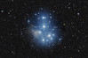 Target:  M45 (The Pleiades, open cluster in Taurus)<br /> <br /> Distance from Earth:  440 light-years<br /> <br /> Image FOV:  232 x 153 arcmins<br /> <br /> Telescope: Takahashi FSQ-106ED refractor (f/5.0) <br /> <br /> Camera: SBIG STL11000M ccd<br /> <br /> Focus: Autofocus<br /> <br /> Images: Captured from GRAS-014 in Mayhill, NM at an image scale of 3.49 arcsec/pixel; 19, 600 sec subexposures; 50 minutes (R), 50 minutes (G) and 90 minutes (B), total exposure time of 190 minutes on Nov 1, 2010<br /> <br /> Processing: MaxIm DL 5.12, Registar 1.0 and Photoshop CS3 with GradientXTerminator and Noise Ninja; image cropped