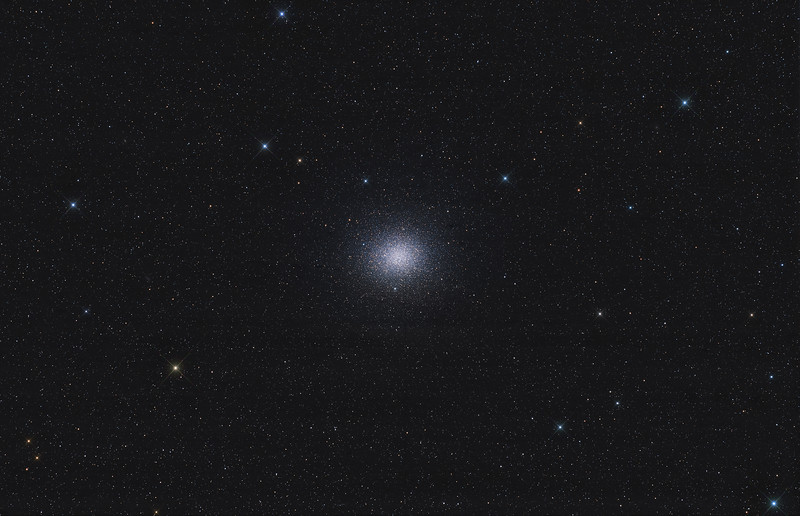 Target:  Omega Centauri (NGC 5139, globular cluster in Centaurus)<br /> <br /> Distance from Earth:  17,000 light-years<br /> <br /> Image FOV:  223 x 144 arcmins<br /> <br /> Telescope: Takahashi FSQ-106ED refractor (f/5.0) <br /> <br /> Camera: SBIG STL11000M<br /> <br /> Images: Data captured at an image scale of 3.49 arcsec/pixel (binned 1x1); 40, 120 sec subexposures; 16 minutes (R), 16 minutes (G), 16 minutes (B) and 32 minutes (L) on Apr 17, 18, 2011; total exposure time of 80 minutes<br /> <br /> Processing: MaxIm DL 5.12, Registar 1.0 and Photoshop CS3 with GradientXTerminator, Noise Ninja and StarSpike Pro; image cropped