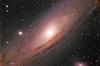 M31 Andromeda Galaxy<br />  <br /> The Andromeda Galaxy is a spiral galaxy approximately 2.5 million light-years from Earth in the constellation Andromeda. Andromeda is the nearest spiral galaxy to the Milky Way, but not the closest galaxy overall. It gets its name from the area of the sky in which it appears, the Andromeda constellation, which was named after the mythological princess Andromeda. Andromeda is the largest galaxy of the Local Group, which consists of the Andromeda Galaxy, the Milky Way, the Triangulum Galaxy M33, and about 30 other smaller galaxies. Although the largest, Andromeda may not be the most massive, as recent findings suggest that the Milky Way contains more dark matter and may be the most massive in the grouping.The 2006 observations by the Spitzer Space Telescope revealed that M31 contains one trillion stars: at least twice the number of stars in our own galaxy, which is estimated to be c. 200–400 billion.<br /> <br />  A 2009 study estimated that the Milky Way and Andromeda are about equal in mass, while a 2006 study put the mass of the Milky Way at ~80% of the mass of Andromeda. The Andromeda Galaxy and the Milky Way are expected to collide in perhaps 4.5 billion years.<br /> <br /> At lower right is the satellite balaxy M110, with about 10 billion suns<br /> At centre left is satellite galaxy M32.<br />  <br /> Orion Optics UK AG16 Astrograph: SBIG 11000 CM: Titan Mount<br /> 25 x 4 minutes<br /> <br /> Data capture 23rd January 2012