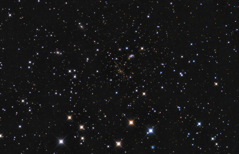 Abell 2218 Galaxy Cluster (central crop)<br /> <br /> Enlargement of the central part of the previous full frame to show the reddish galaxy cluster, 2 billion light years away, more clearly near the centre<br /> <br /> Orion Optics UK AG16 Astrograph: SBIG 11000 CM: Titan Mount<br /> 51 x 5 minutes minutes (4hr 5minutes total) single shot colour, processed with CCDStack, Photoshop, Pixinsight. <br /> <br /> Data capture: around midnight, 20th April 2013, waxing moon at 70%
