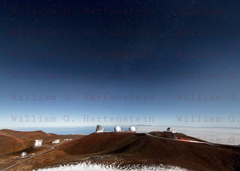 Mauna Kea Observatory Summit and the Milky Way with the Island of Maui. 2-03-17
