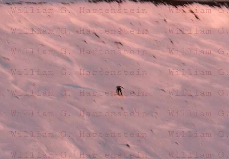 Snowboarder heads down a slope at the Mauna Kea Observatory Summit 12-03-2017