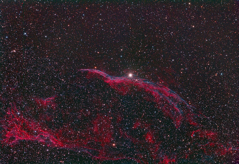 "Veil Nebula West (also known as Caldwell 34), with NGC 6960, the ""Witch's Broom"", near the centrally located foreground star 52 Cygni <br /> Reprocessed in March 2013<br /> <br /> The Veil Nebula is a cloud of heated and ionized gas and dust in the constellation Cygnus. It makes up the visible portions of the Cygnus Loop, a large but relatively faint supernova remnant. The source supernova exploded some 5,000 to 8,000 years ago, and the remnants have since expanded to cover an area roughly 3 degrees in diameter (about 6 times the diameter, or 36 times the area, of the full moon). The distance to the nebula is not precisely known, but recent evidence from the Far Ultraviolet Spectroscopic Explorer (FUSE) supports a distance of about 1,470 light-years.<br /> <br /> The whole Veil Nebula was discovered on September 5, 1784, by William Herschel. He described the western end of the nebula as ""Extended; passes thro' 52 Cygni... near 2 degrees in length"".<br />  <br /> WO 132 FLT with TMB field flattener: SBIG 11000 CM: Titan Mount<br /> 20 x 6 minutes<br /> <br /> Data capture 4th September 2010, reprocessed March 2013"