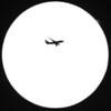 Plane against sun