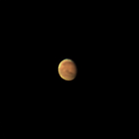 "Target:  Mars (North is up, diameter 10.2"", magnitude -0.2)<br /> <br /> Altitude:  68.6 degrees<br /> <br /> Image FOV:  60 x 60 arcsec<br /> <br /> Date/Time:  10/08/07 0530 EDT<br /> <br /> Mount:  Takahashi NJP Temma II<br /> <br /> Telescope:  Takahashi TOA-130 refractor with TeleVue 5.0x PowerMate (f/38.5) and Baader IR/UV blocking filter<br /> <br /> Camera:  Lumenera Lu075c<br /> <br /> Focus:  Finger Lakes Instrumentation DF-2  focuser<br /> <br /> Sky conditions:  transparency 3/5, seeing 4/5, surface winds 0-5 mph, winds at 300mb 20-30 knots, humidity 90-95%, temp I/O 64.6/64.4F<br /> <br /> Images:  Captured with LuCam Recorder 1.7.0.21 at an image scale of 0.30 arcsec/pixel; 1463 frames captured over 60 seconds (24.3 fps)<br /> <br /> Processing:  SER image file was processed in RegiStax 4.0.1.1, the best 800 frames were aligned and stacked.  Post-processing in Photoshop CS3 (revised 06/14/08)"