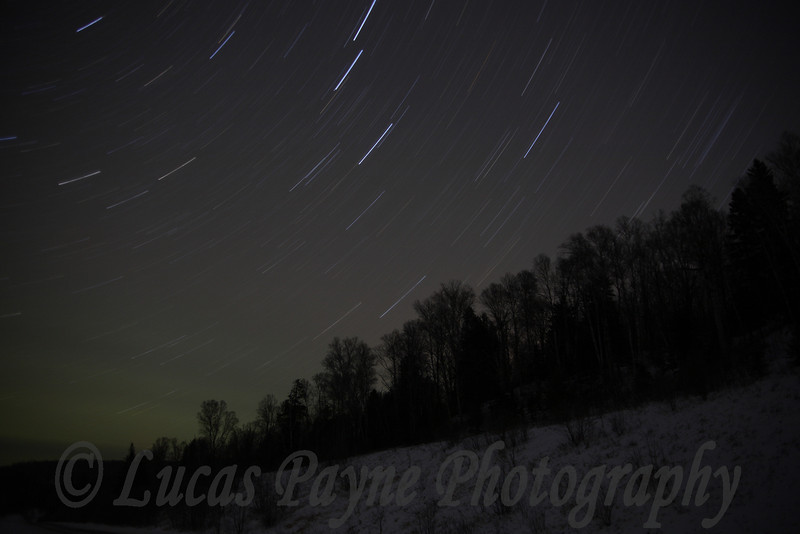Star Trails over the Sawbill Trail in Minnesota. The green glow in the lower left corner is from the northern lights.