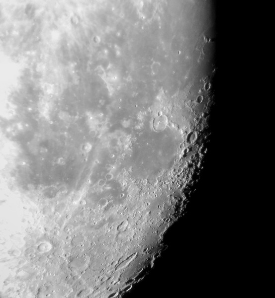 "iPhone shot of the moon through 15mm eyepiece on 11"" Celestron Edge SCT through a double pane window"
