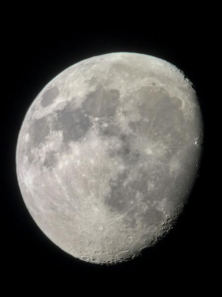 "iPhone shot of the moon through 35mm eyepiece on 11"" Celestron Edge SCT through a double pane window"
