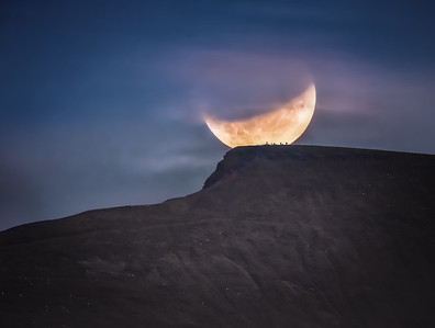 Partial eclipse of the moon above Pen y Fan