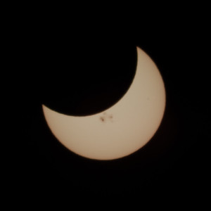 Solar eclipse with sunspots