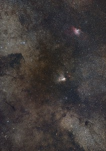 Swan and Eagle Nebulae and dark lanes of the Milky Way