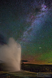 The Milky Way and Aurora Borealis over Old Faithful, Yellowstone National Park
