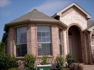 "<font face=""Comic Sans MS"" size=""2"">The front of the model home </font>"