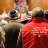 "A parishioner, wearing a sweater with the message ""Fighting hate, teching tolerance, seeking justice"" listens in to the Interfaith Community Gathering at Congregation Agudat Achim in Leominster on Friday evening. Ther service was to promote unity, love, respect, healing and hope on the day of the Inauguration. SENTINEL & ENTERPRISE / Ashley Green"
