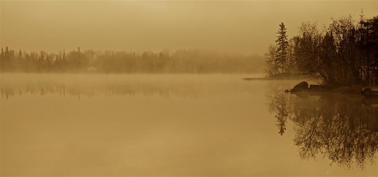 mist on a calm lake