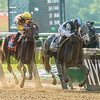 Tapwrit with jockey Jose Ortiz passes Irish War Cry with jockey Rajiv Maragh to win the 149th running of the Belmont States June 10, 2017 in Elmont, N.Y.  Photo by Skip Dickstein