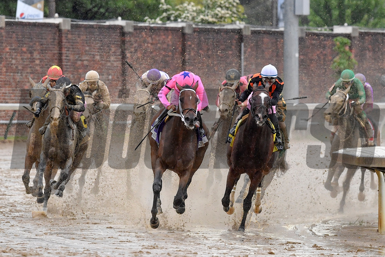 Mike Smith takes Abel Tasman, outside, from last to first in the Kentucky Oaks.