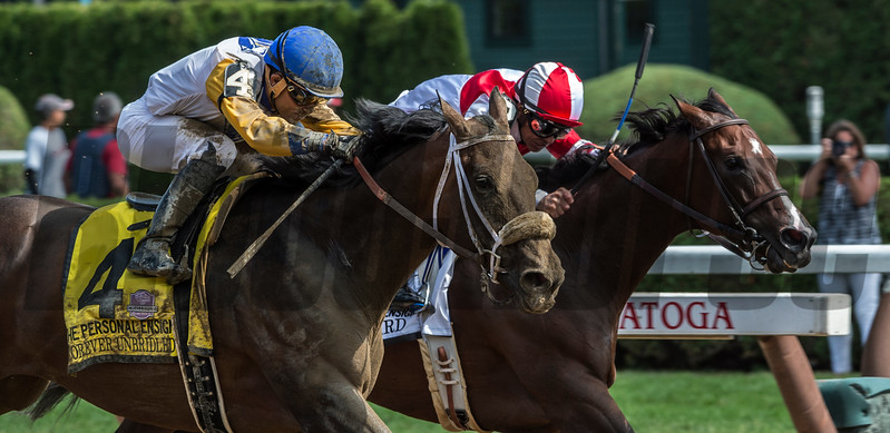 Forever Unbridled with jockey Joel Rosario looms up on the outside to beat Songbird with Mike Smith up just short of the wire to win the 70th running of The Personal Ensign at the Saratoga Race Course in Saratoga Springs, N.Y.  (Skip Dickstein
