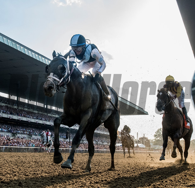 Tapwrit with jockey Jose Ortiz passes Irish War Cry with Rajiv Maragh on the way to the win in the 149th running of the Belmont States June 10, 2017 in Elmont, N.Y.  Photo by Skip Dickstein