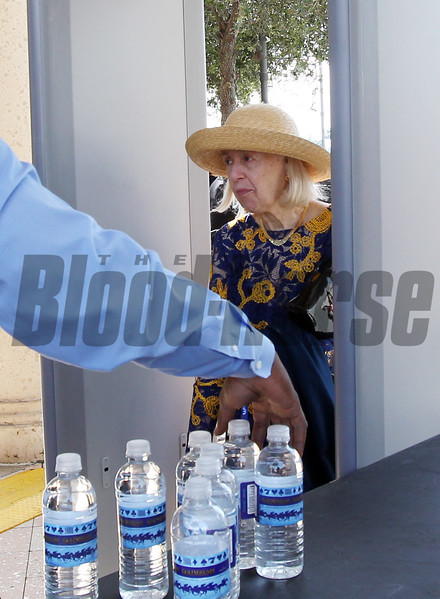 Mrs. Elfriede Stronach passes through Security, 2017 Pegasus World Cup