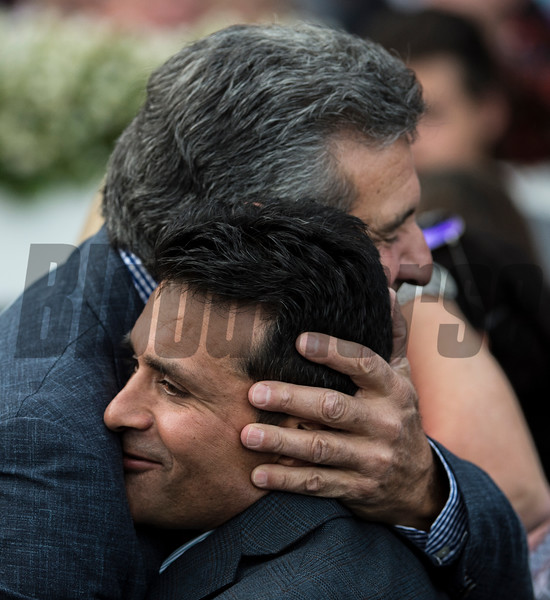 Principal owner of Lady Ivanka Michael Dubb gives trainer Rudy Rodriguez a hug after winning the 126th running of The Spinaway Saturday Sept. 1, 2017 at the Saratoga Race Course in Saratoga Springs, N.Y. (Skip Dickstein