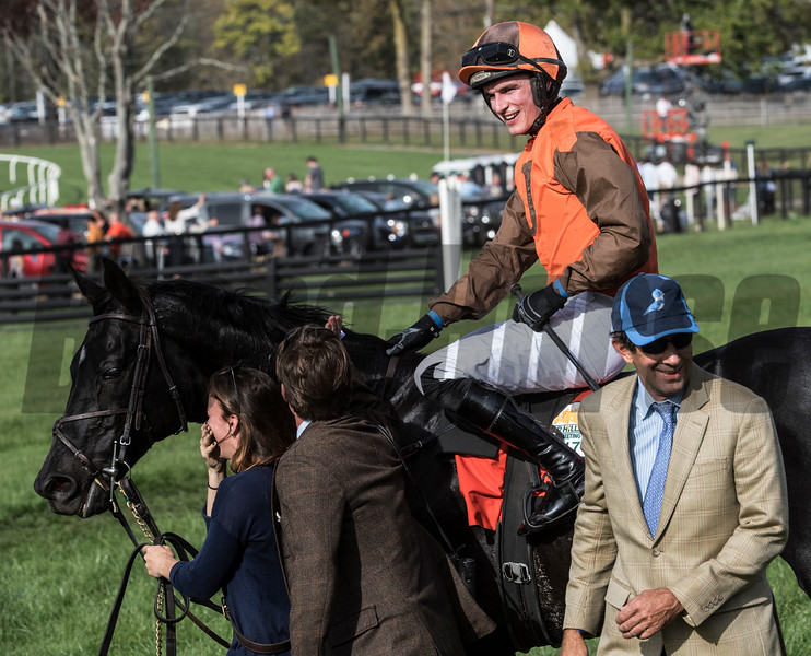 Jockey Danny Mullins is all smiles after Mr.Hot Stuff won the Grand National Steeplechase race at Far Hills Race Course  Oct. 21, 2017 in Far Hills, N.J. Trainer Jack Fisher is lower right.   Photo by Skip Dickstein