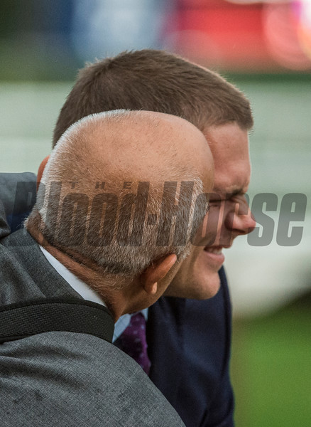 Trainer Mark Casse gives his son and assistant trainer Norman Casse a big kiss after their charge World Approval won the 33rd running of The Fourstardave at the Saratoga Race  Course Aug. 12, 2017  in Saratoga Springs, N.Y.  (Skip Dickstein